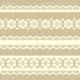Vintage straight lace on linen canvas background. Royalty Free Stock Photography