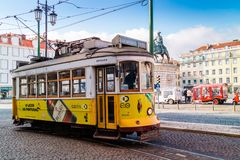 Vintage street car in the old city centre of Lisbon. LISBON , PORTUGAL - FEBRUARY 9, 2018: Vintage yellow tram at the Praca do Comrcio, Commerce Square in Royalty Free Stock Photos