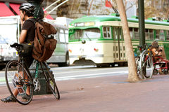 Vintage Street Car Passes Waiting Cyclist In San Francisco Royalty Free Stock Images