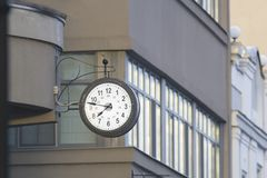 Vintage street clock on the city building royalty free stock photos