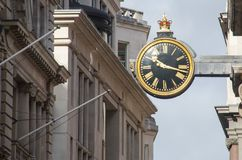 Vintage street clock in city of London Royalty Free Stock Images