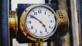 Vintage street clock. Old, antique, analog outside Stock Photography