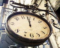 Vintage street clock. Retro concept royalty free stock photography