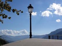 Vintage street lamp against blue sky Stock Image