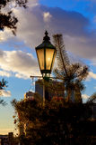 Vintage street lamp, bokeh lights and leaves of trees,. The background of the sky Stock Photos