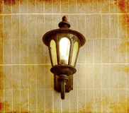 Vintage street lamp on brick wall, in old image style Stock Image