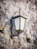 Vintage street lamp hanging on the old wall Stock Image