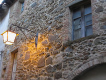 Vintage street lamp in medieval village at twilight. Tuscany, Italy Royalty Free Stock Image