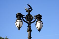 Vintage street lamp post with ship sculpture in London, England stock photos