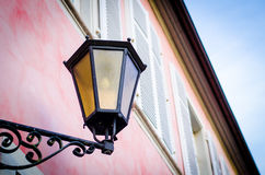 Vintage street lamp on red house Stock Image