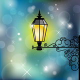 Vintage street lamp with shiny background Stock Images