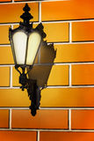 Vintage street lamp on the wall. Wall lamp with textured background Stock Photo