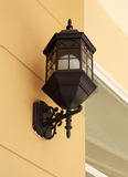 Vintage street lamp on wall Stock Photo