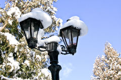 Vintage street lamppost covered in snow, Sinaia, Romania Royalty Free Stock Image