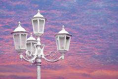 Vintage street lamppost. In sunset time Stock Images