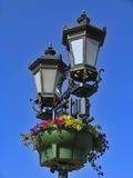 Vintage street lamps against bright blue sky Royalty Free Stock Photography
