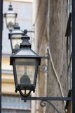 Vintage street lamps on wall. In Stockholm Royalty Free Stock Photos