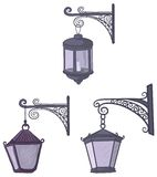 Vintage street lanterns. Set vintage street non-luminous lanterns with extinct candles, hanging on a decorative brackets royalty free illustration