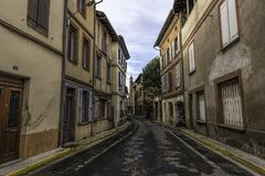 Vintage street leading to main cathedral in the distance of an old town in southern France royalty free stock photo