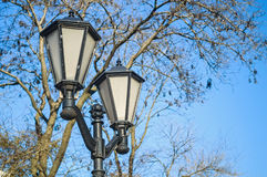 Vintage street light against the blue sky Royalty Free Stock Images