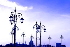 Vintage street lights. Moscow city evening panorama. Stock Photography