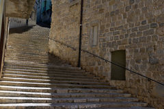 A vintage street of with so many stairs at El Call, the old Jewish neighborhood of Girona. Royalty Free Stock Photos