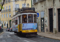 Vintage Streetcar - Tram running through the old streets of the Alfama District Lisbon Portugal Royalty Free Stock Image