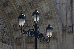Vintage streetlamp with church portal in the back Stock Photography