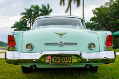 Vintage Studebaker Automobile. Miami, FL USA - March 12, 2017: Close up view of the rear end of a beautifully restored vintage 1955 Studebaker Commander Stock Photos