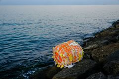 Vintage stuffed buoy washed off to the shore stock photo