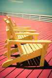 Vintage Style Adirondack Chairs on Deck Stock Images