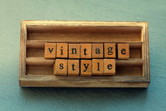 Vintage style. Aged wooden letter word, wood box background. Vintage style. retro wooden letter word, wood box background Royalty Free Stock Image