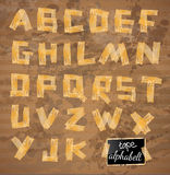 Vintage style alphabet made of yellow distressed tape Royalty Free Stock Photography