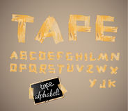 Vintage style alphabet made of yellow distressed tape Royalty Free Stock Photo