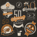 Vintage style 50 anniversary collection. Fifty anniversary design in retro style. Vintage labels for anniversary greeting. Hand lettering style typographic and Stock Images