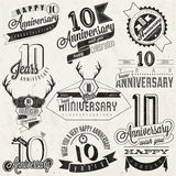 Vintage style 10 anniversary collection. Ten anniversary design in retro style. Vintage labels for anniversary greeting. Hand lettering style typographic and Royalty Free Stock Photo