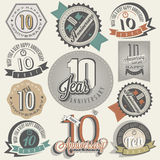 Vintage style 10 anniversary collection. Ten anniversary design in retro style. Vintage labels for anniversary greeting. Hand lettering style typographic and Stock Photos