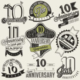 Vintage style 10 anniversary collection. Ten anniversary design in retro style. Vintage labels for anniversary greeting. Hand lettering style typographic and Stock Photo