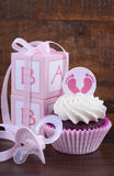 Vintage Style Baby Shower Cupcake and Gift Box Royalty Free Stock Photography