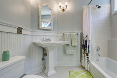 Vintage style bathroom with white interior. Royalty Free Stock Photography