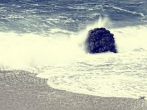 Vintage style beach with rock sand and wave Royalty Free Stock Photos