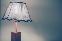 Vintage style bed lamp with green wall Royalty Free Stock Image
