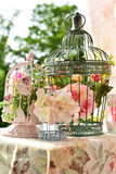 Vintage style bird cages with flowers Stock Photos