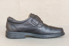 Vintage style Black leather shoes on gray background Royalty Free Stock Photography