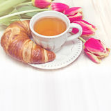 Vintage style breakfast tea and flowers Stock Photos
