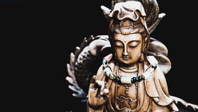 Vintage style of Buddha statue with light dark background Royalty Free Stock Photos