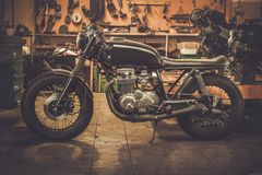 Vintage style cafe-racer motorcycle. In customs garage