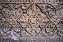 Vintage style carving art on stone brick wall Stock Image