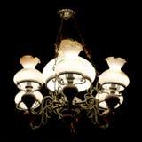 Vintage style chandelier lighting in the dark Stock Photos
