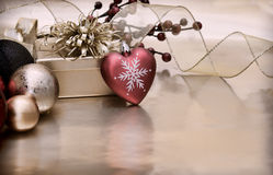 Vintage style Christmas background. With a heart shaped bauble Royalty Free Stock Image